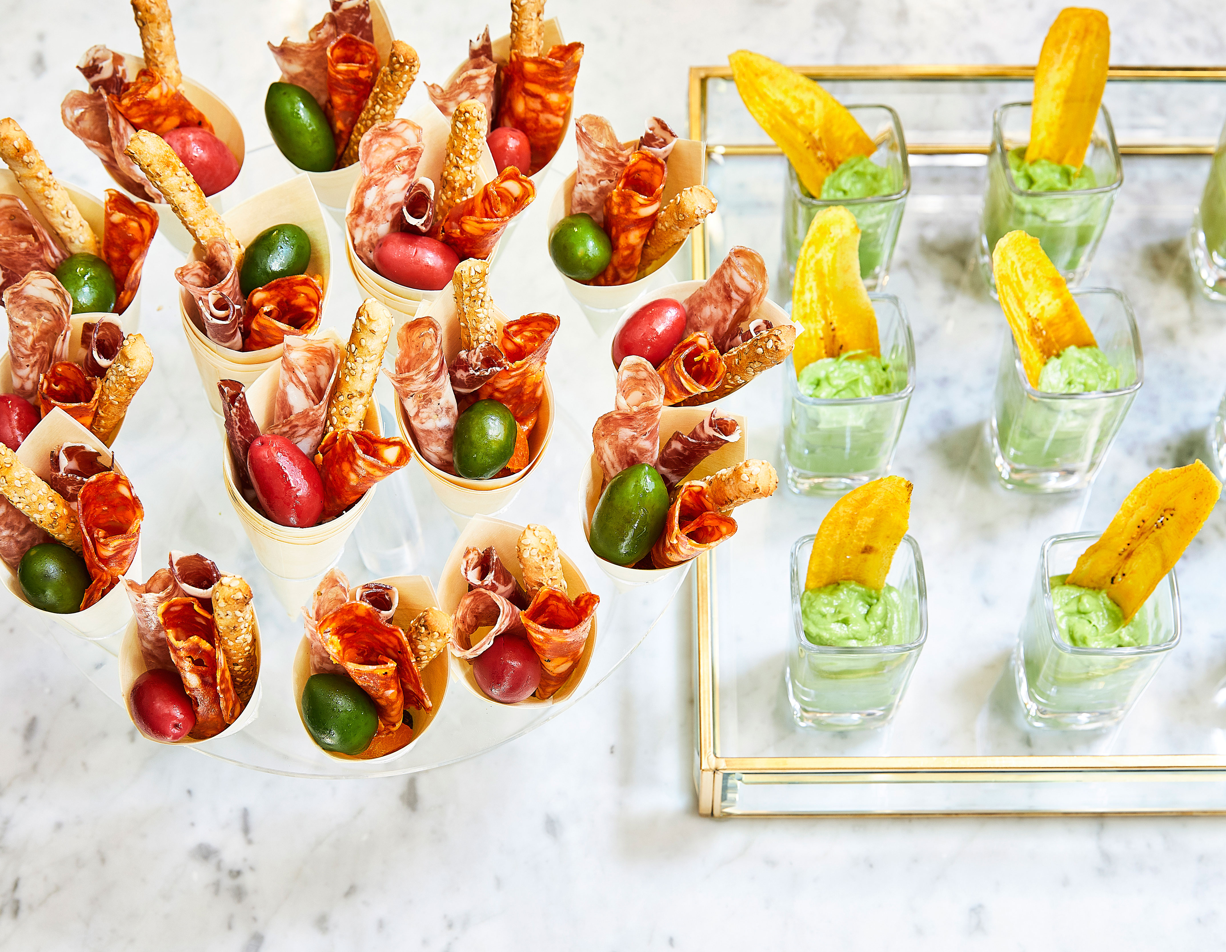 hors d'oeuvres set up on a glass platter